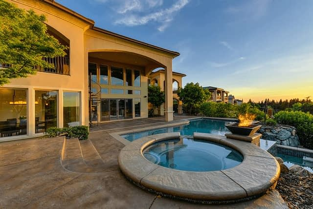 mansion at sunset with beautiful green landscaping