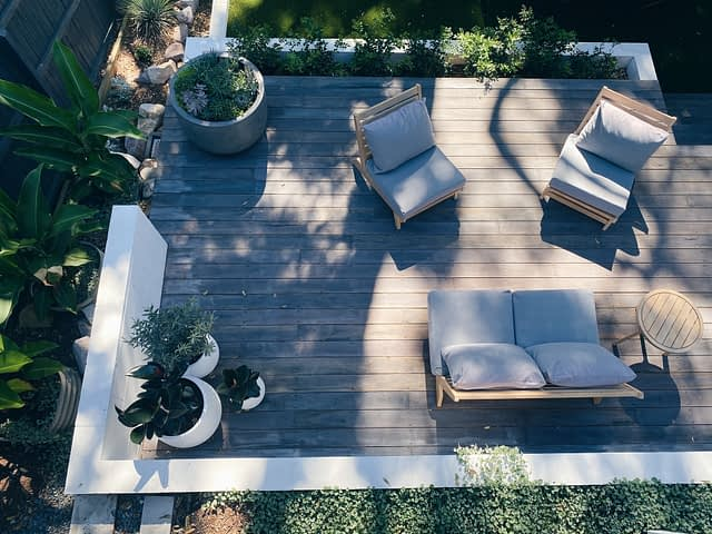 above view of wooden patio with gray patio furniture